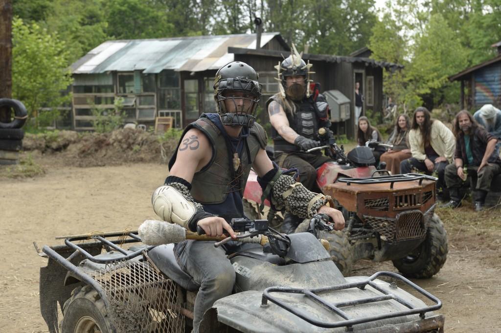 Two warrior hillbillies on 4 wheelers